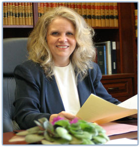 Photo of Judge Martha Geer sitting at her desk in her office
