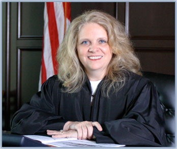 Photo of Judge Martha Geer sitting on the bench in her courtroom